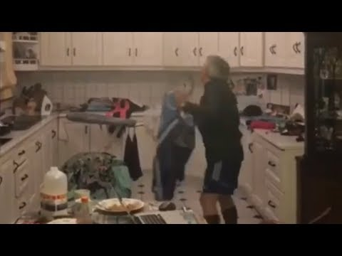 Just and Irish Family trying to catch a Bat in Their Kitchen
