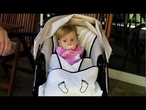 Cute baby in a cozy stroller blanket from Elli&Nooli Baby Products
