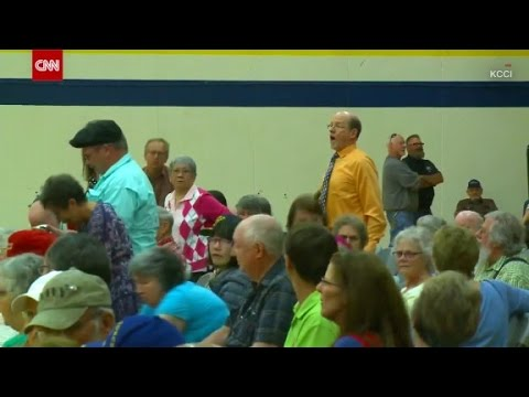 """Crowd sings """"We Shall Overcome"""" at Town Hall"""