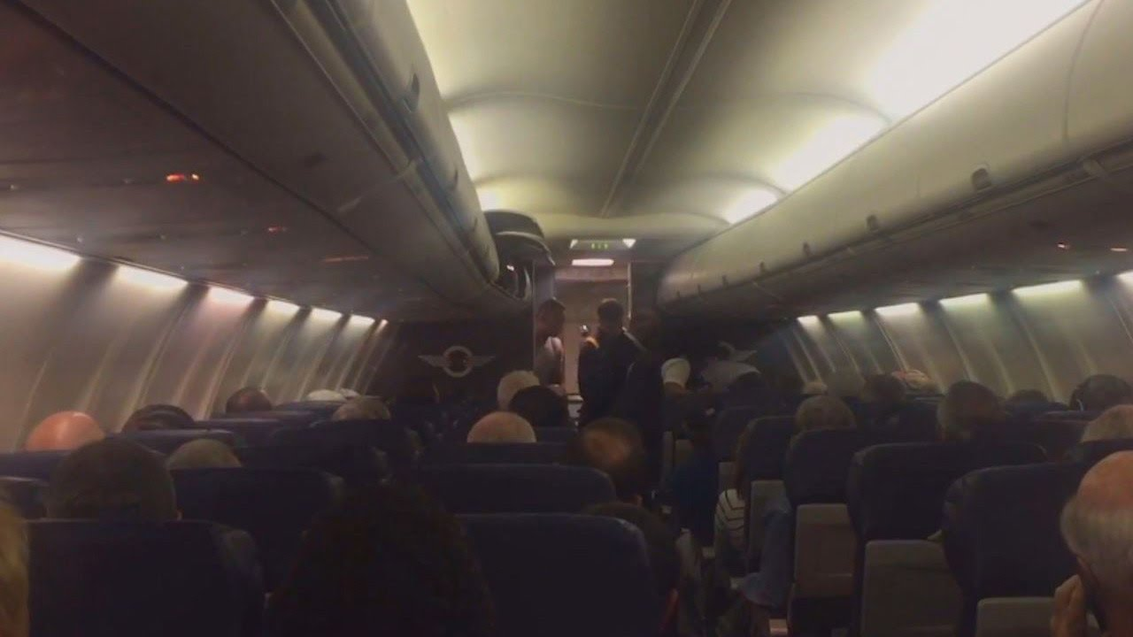 Passenger on an airplane tries to fight fire with fire when a screaming baby boards a plane