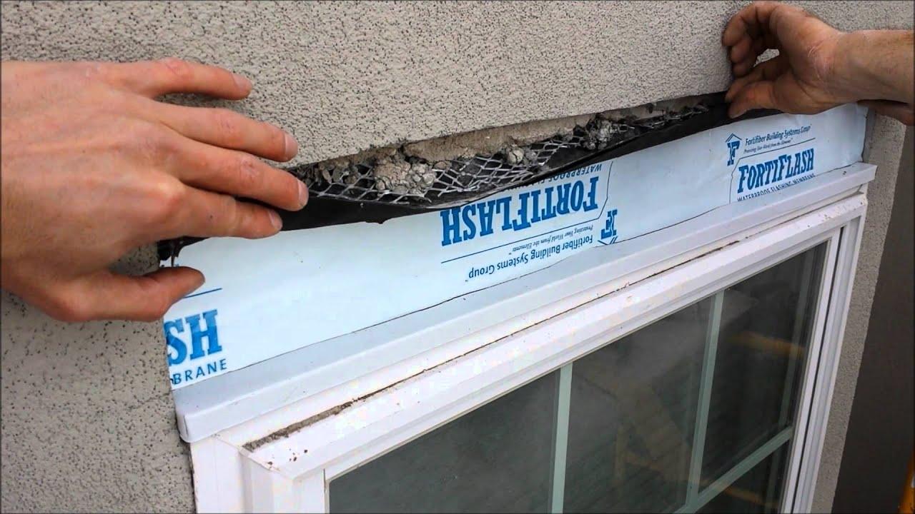 Water damage stucco stone veneer youtube for How to install stone veneer over stucco