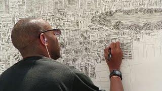 بالفيديو..الرجل الذي يرسم مدينة كاملة من نضرة واحدة ...كامرا بشرية