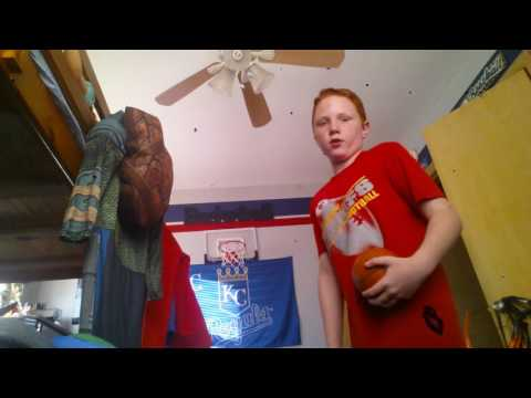 Dunking on mini basketball hoop