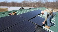 Canticle Farms, Allegany, NY installing solar panels
