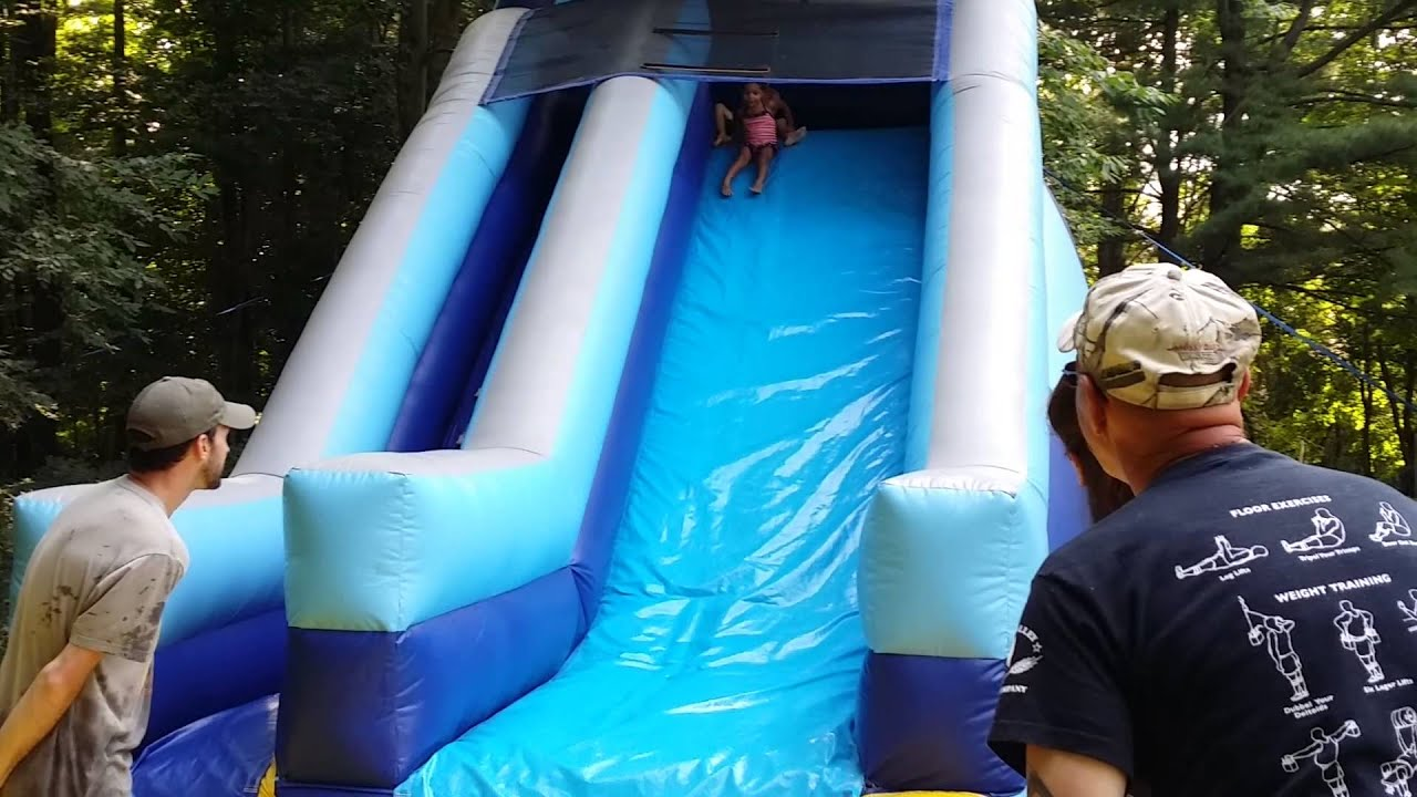 Kids Playing On A Giant Blow Up Water Slide Youtube