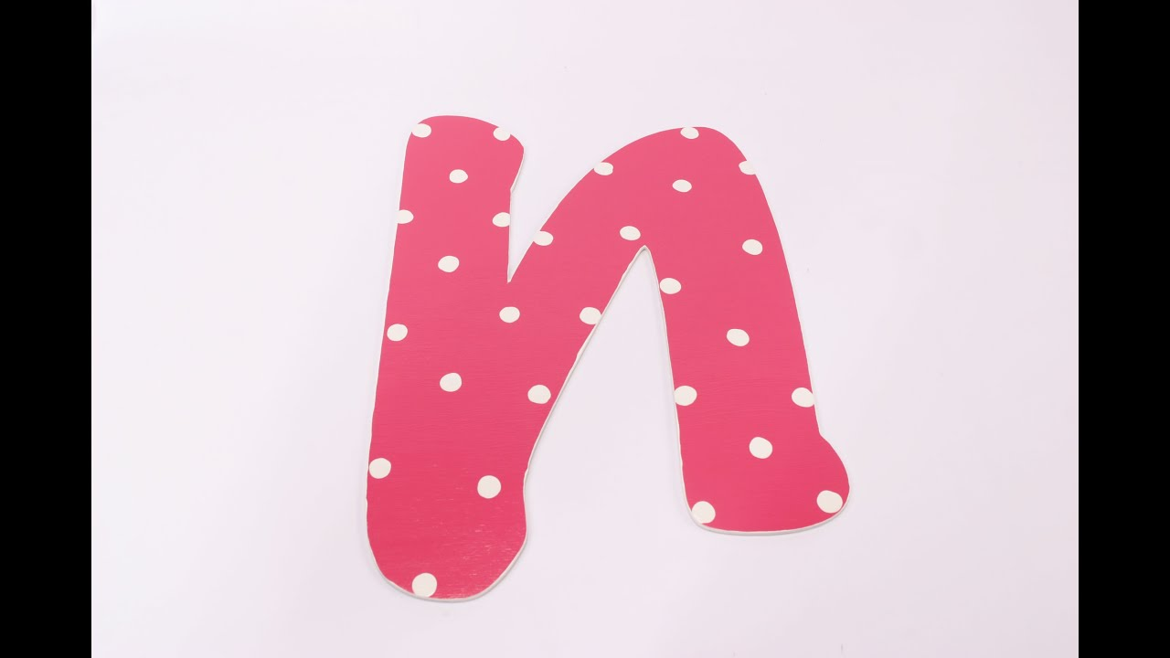 paint white polka dots on pink letters