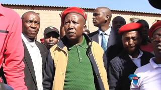 Malema stands up to police