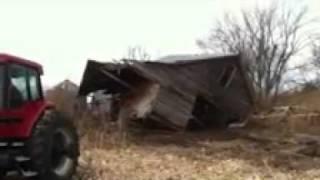 7240 Tractor Pulls A Corn Crib Building Apart