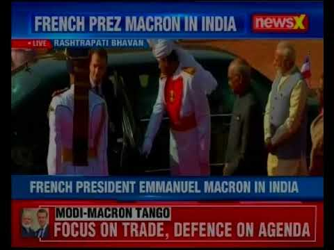 French President Emmanuel Macron inspects guard of honour at Rashtrapati Bhawan