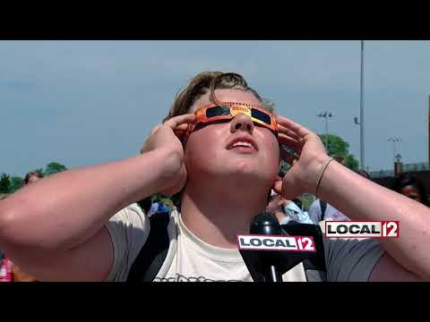 Students at Walnut Hills High School gather at football field to witness eclipse