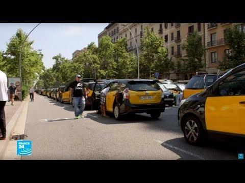 سائقو سيارات الأجرة في مدريد يضربون احتجاجا على -أوبير-