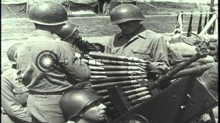 American soldiers fire a 40 mm anti aircraft gun and two German airplanes are sho...HD Stock Footage