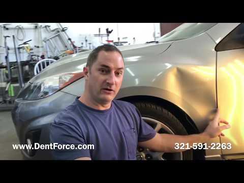 Huge dent in a Mazda 3. Paintless dent Repair in Merritt Island, Cocoa, Melbourne, Titusville.