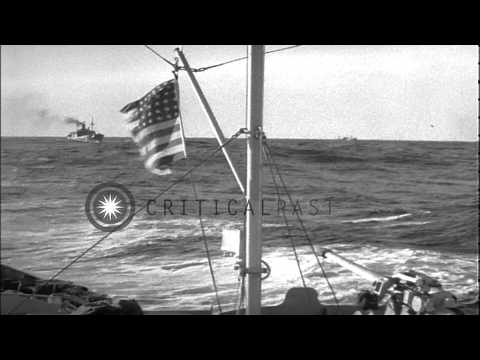 The USCGC Campbell with merchant ships in a convoy during World War II HD Stock Footage