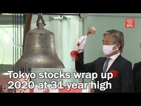 Tokyo stocks end 2020 at 31-year high