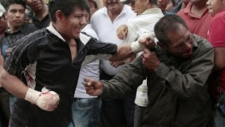mexican men women and children hold fist fights in the street in honor 500 year old tradition