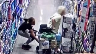 Security camera catches thief swiping elderly woman's purse