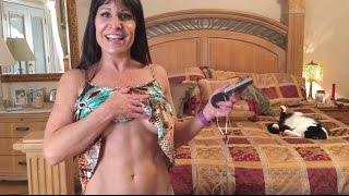 Muscle stimulator Funny Farm Girl stimulating her pectoral and abdominal muscles