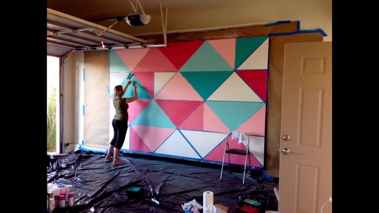 How to paint a giant geometric feature wall mural youtube for A mural is painted on a
