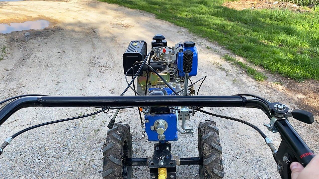 Diesel walk behind tractor in the mud