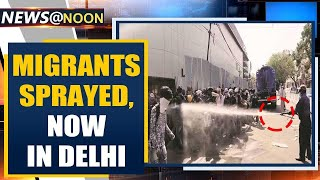 Migrants sprayed with disinfectant in South Delhi, authority says 'mistake' | Oneindia News