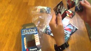 Opening a box of Beckett hockey trading cards and a retail