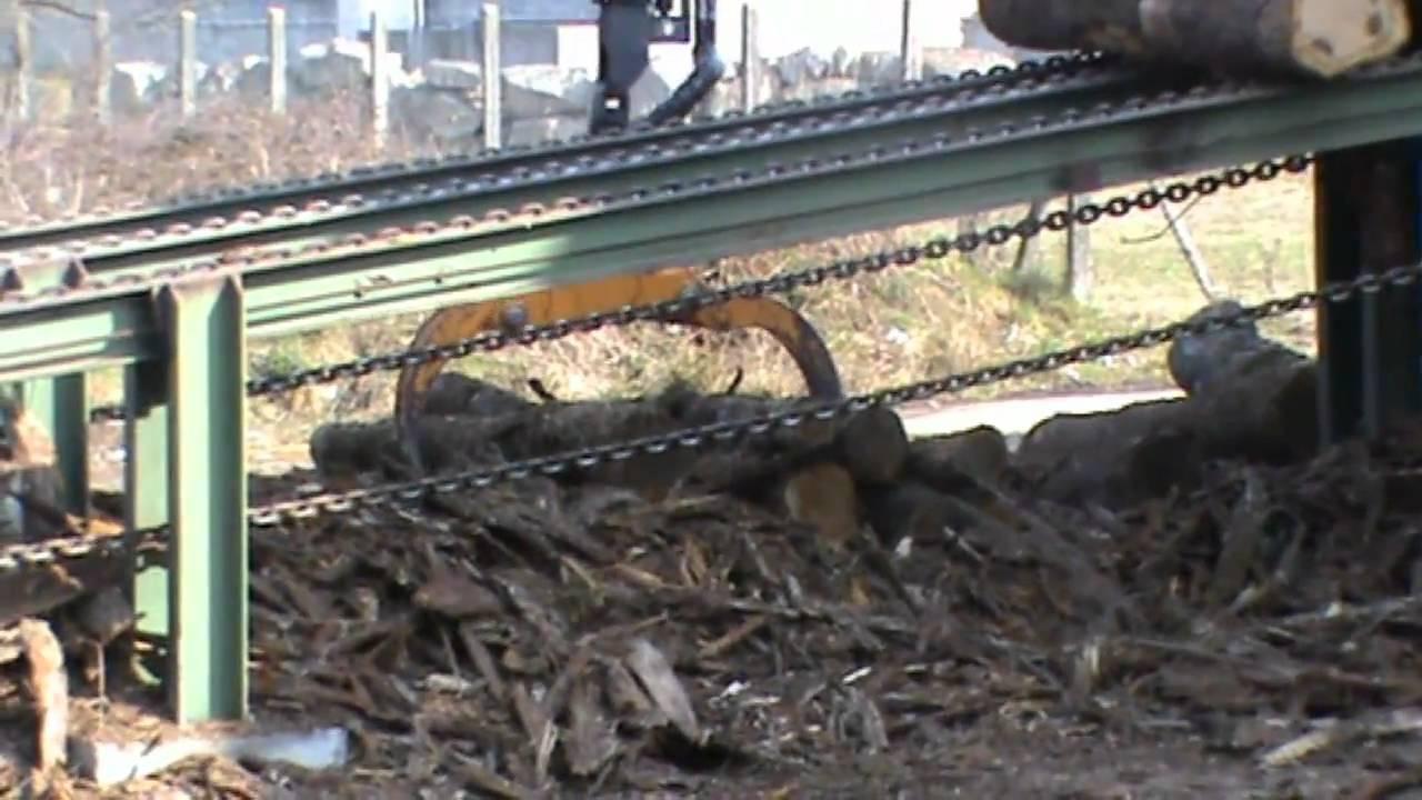 Alimentation convoyeur bois de youtube for Chauffage bois pour piscine