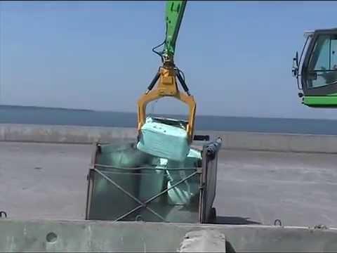 SENNEBOGEN - Material Handling: 850 Mobile Material Handler loading waste bales from ship to truck