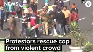 Watch: Protestors rescue cop from violent crowd