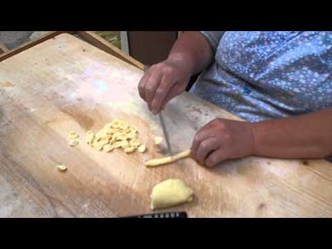 Italian woman makes pasta shells by hand