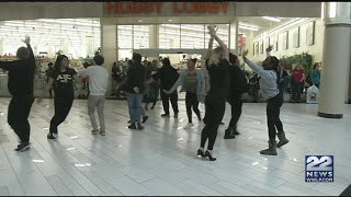 AIC students perform flash mob at Holyoke Mall