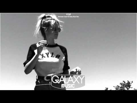 XYLØ - Between The Devil And The Deep Blue Sea