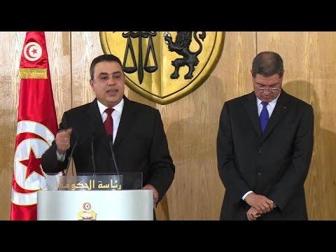 Tunisia's secular-Islamist coalition takes office