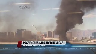 Passengers on board burning plane talk about going aboard another aircraft