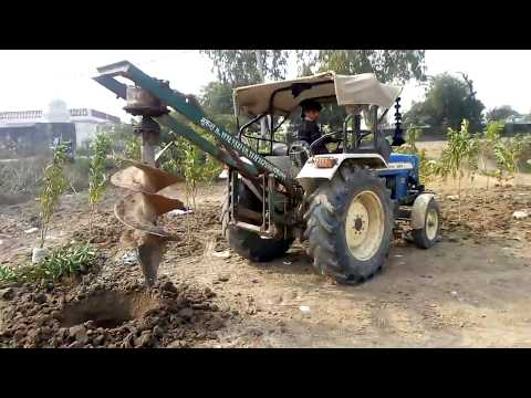 New holland 3630 tractor drill hole for tree in the field