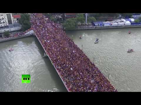 Thousands of devotees join massive Black Nazarene procession in the Philippines