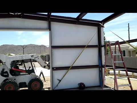 Installing insulation on a Steel Building Queen Creek, AZ