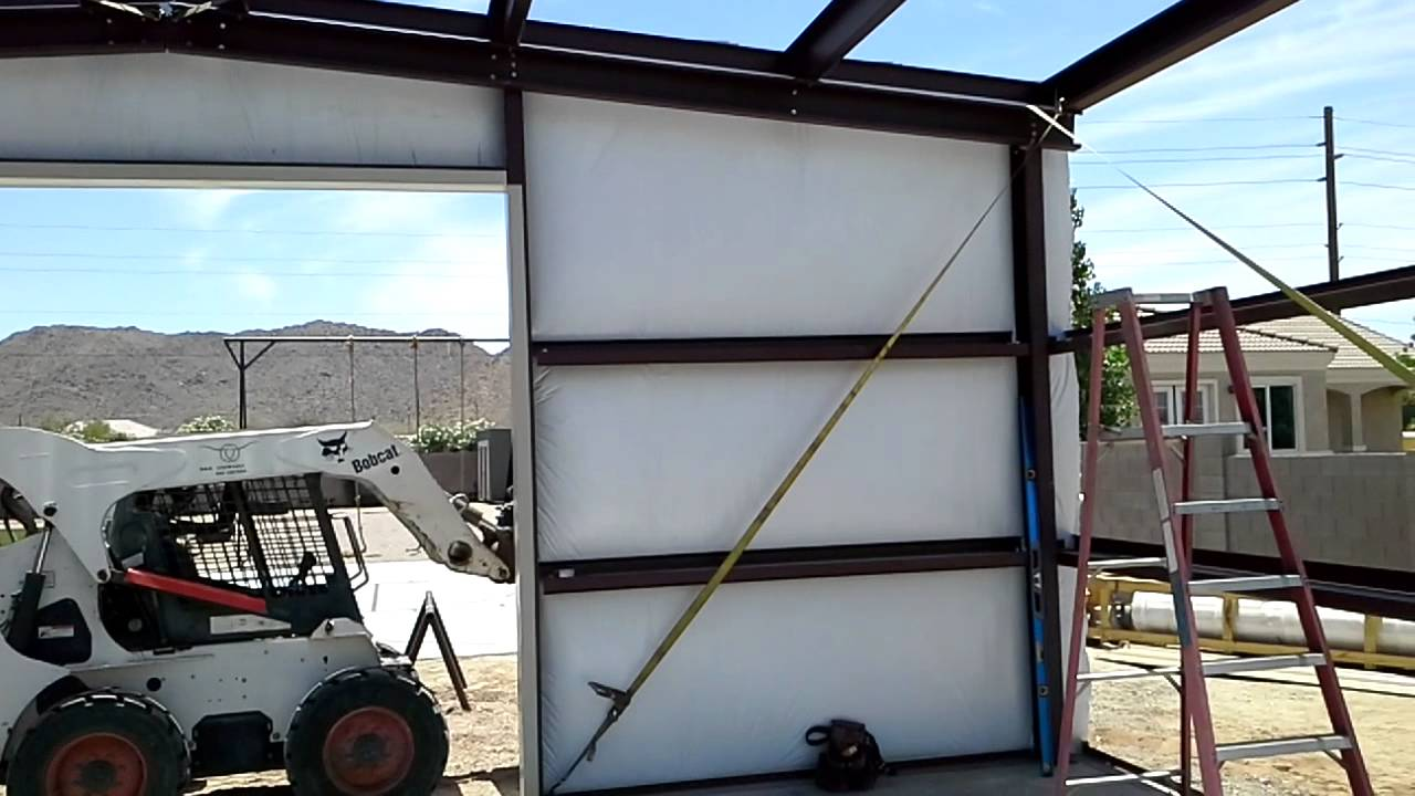 Installing insulation on a Steel Building Queen Creek AZ
