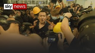 Protesters detain man they believed to be an undercover police officer