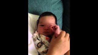 """9 days old baby learning how to close open hand"""",)"""