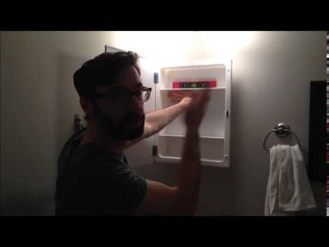 Install a surface mount medicine cabinet - YouTube