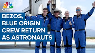 Jeff Bezos and Blue Origin crew return as astronauts after historic launch