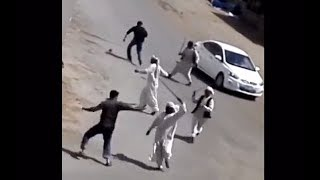 Group stick fight in street