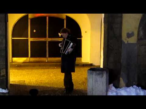 Musician playing accordion in the streets of Prague