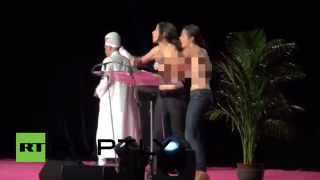 Topless FEMEN activists kicked out of Muslim Conference, Paris