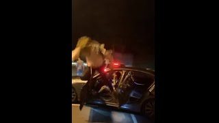 Guy Opens The Car Door As His Friend Was Jumping Off The Top, Giving Him A Painful Nut Shot