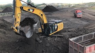 Cat 352F Excavator Loading Coal On Trucks