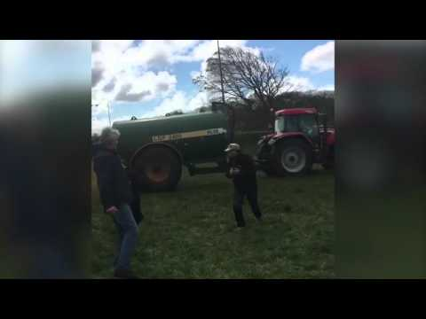 farmer sprays manure at Oscas ar winning actress Emma Thompson