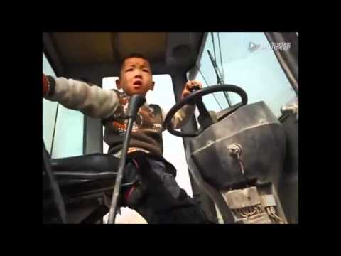 5 Year-old Chinese Boy Operating a Tractor Like a Boss