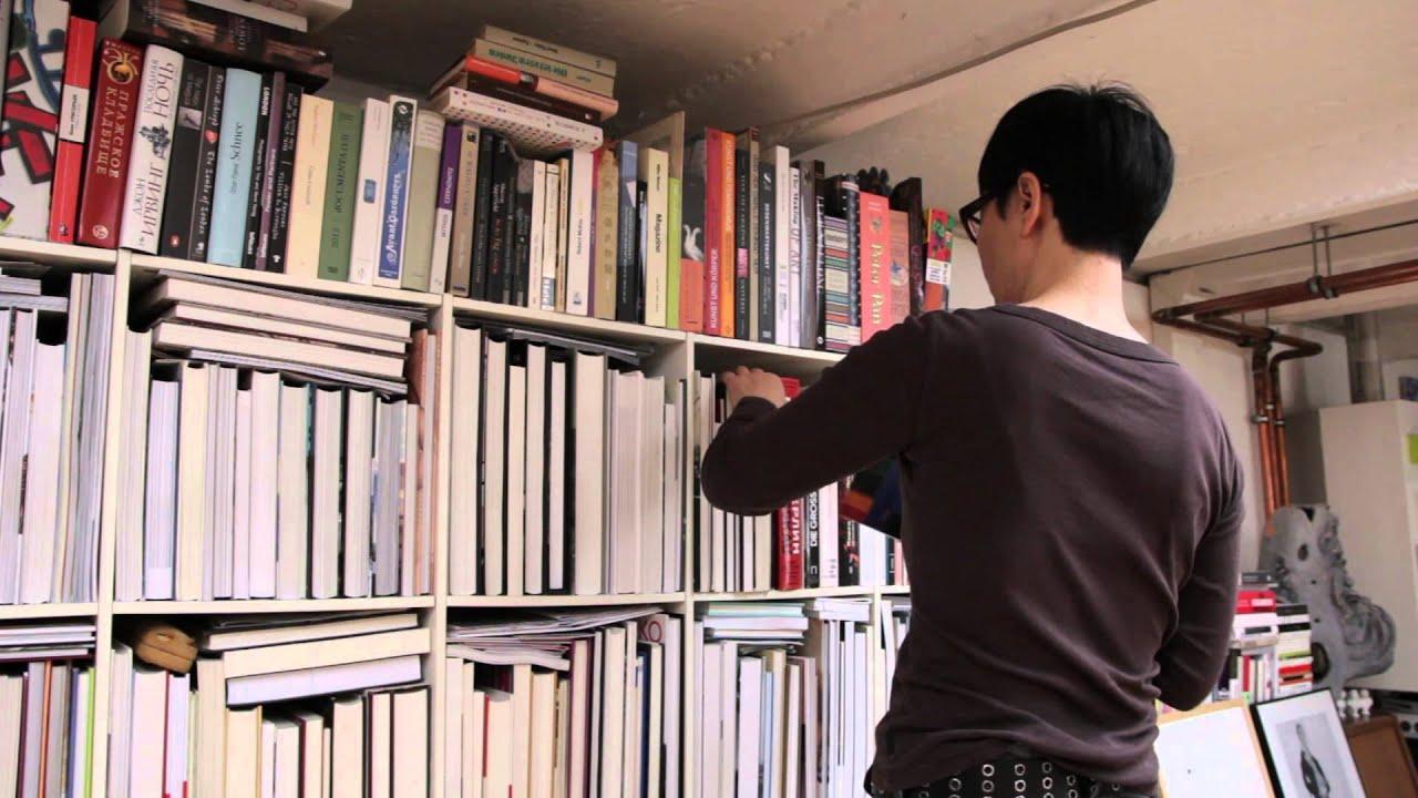 An Orange Line Passing Through The Inverted Bookshelf